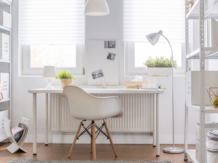 white desk and chair in a white room