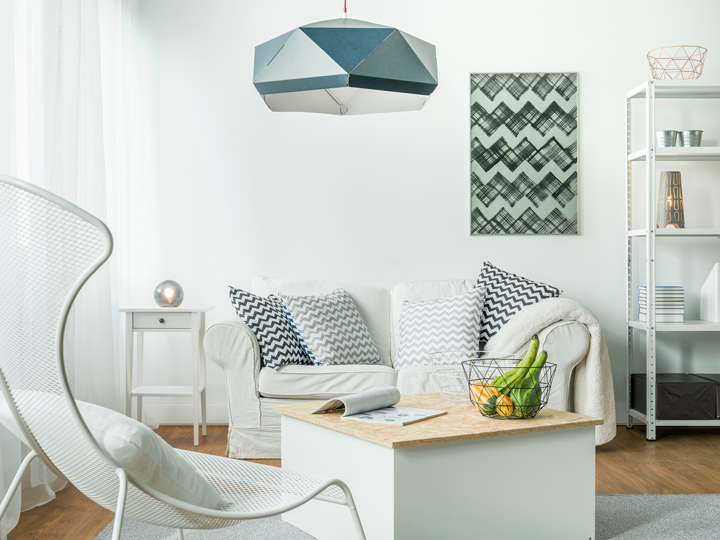 white room with colorful patterned prints on the wall
