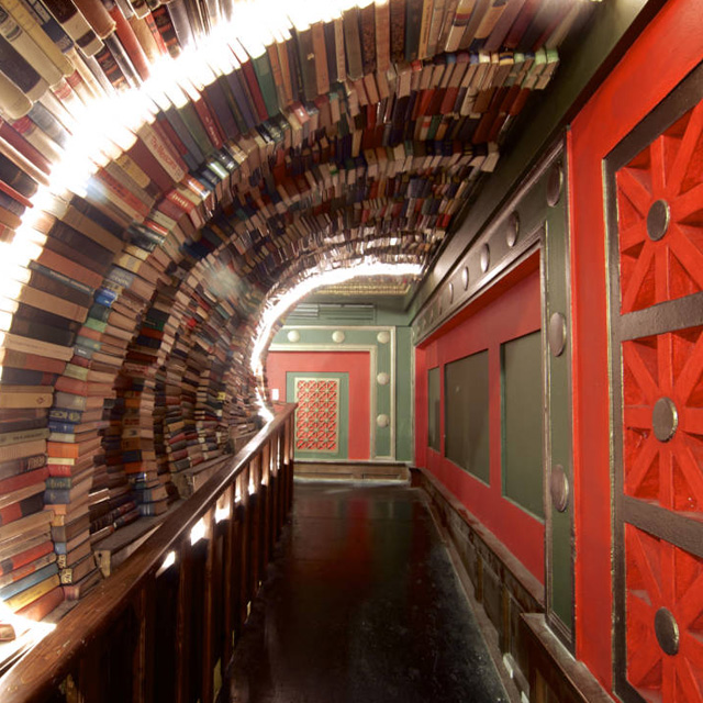 colorful hallway made of an arch of books