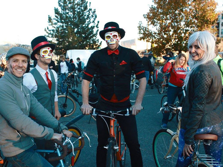 people in costume on bicycles