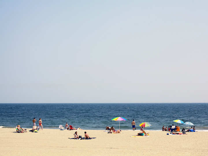 people in swimsuits on a sandy beach