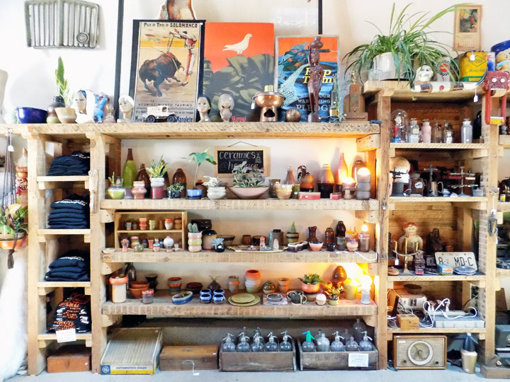 rough-cut shelves filled with various merchandise