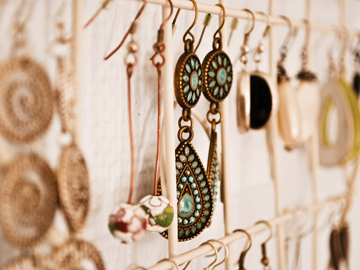 rows of earrings hanging on a display