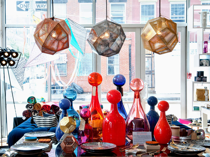 store window filled with bright house accessories