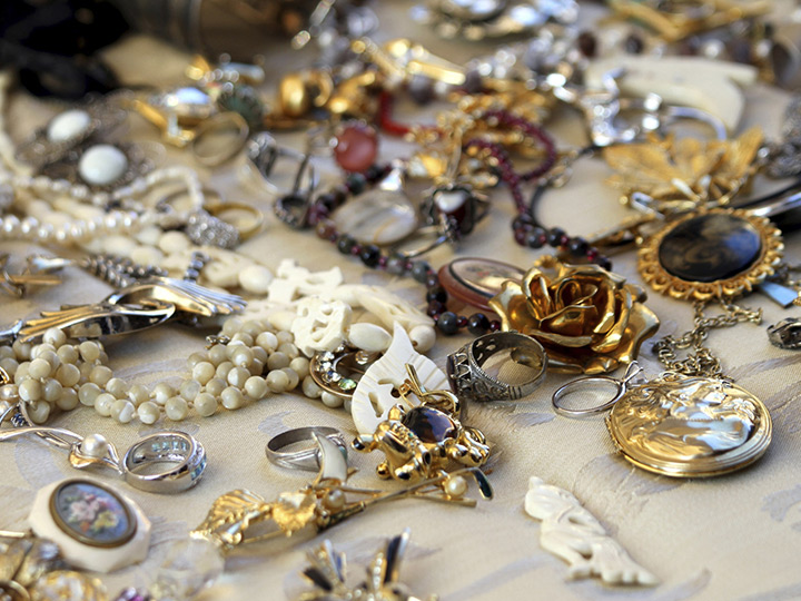 a variety of old jewelry scattered on a table