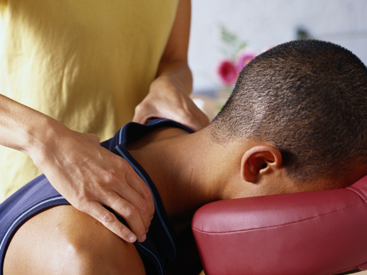 person getting a shoulder massage