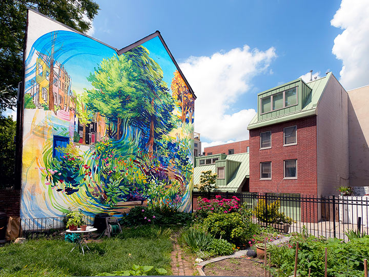 colorful impressionist mural on the wall of a building