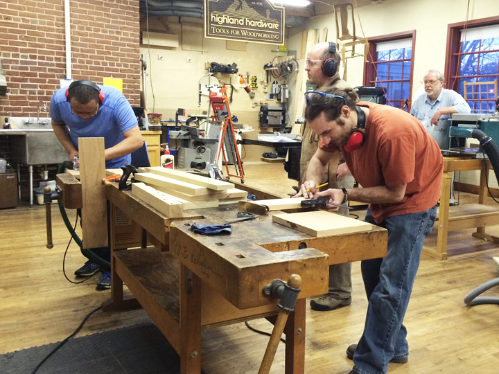 several people working in a wood shop