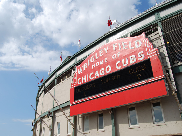 exterior of baseball stadium with Wrigley Field sign