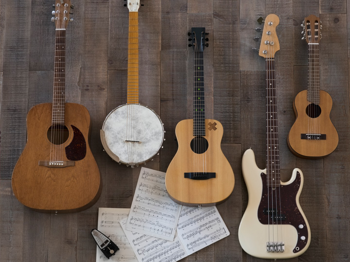 four guitars and a banjo