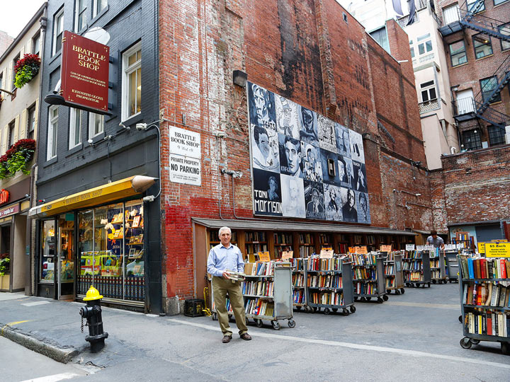 street view of Brattle Book Shop with shelves of books outside