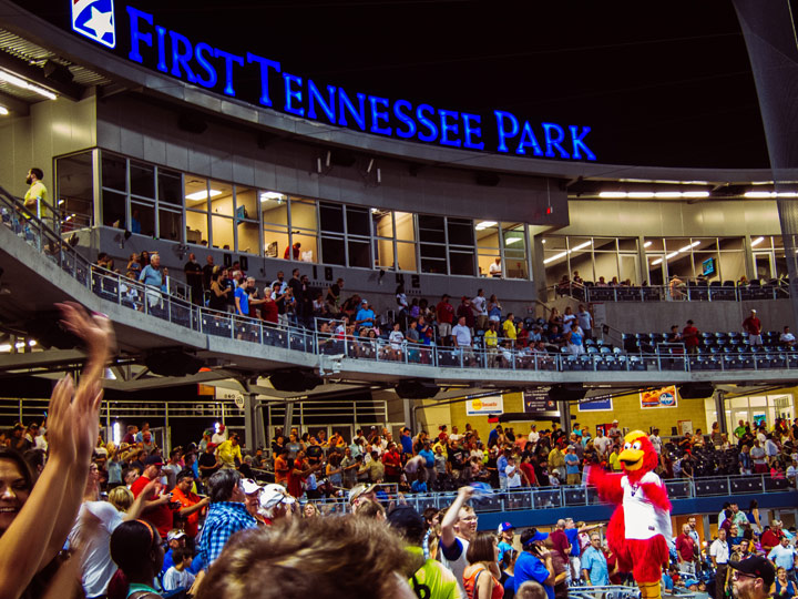 picture of crowd in a baseball stadium with lit up sign saying First Tennessee Park