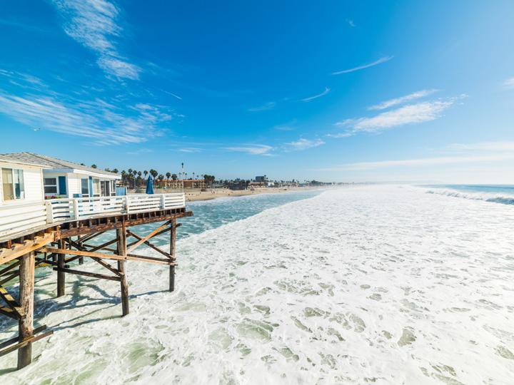gentle, foamy waves on a sandy beach