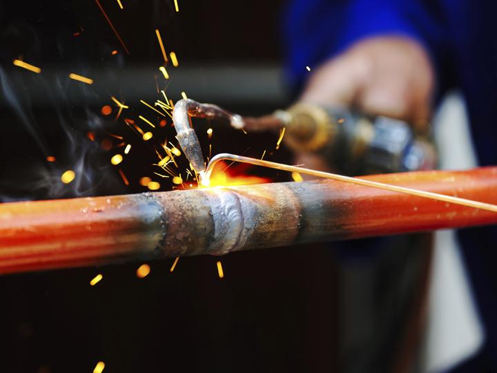 a torch welding a bike frame