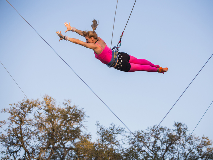 woman leaping from a trapeze