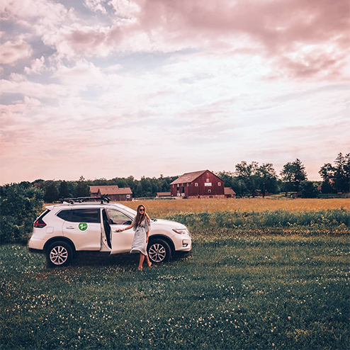 woman with zipcar in field