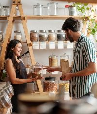 man and woman in plastic free shop