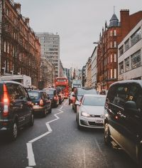 a busy london street filled with traffic