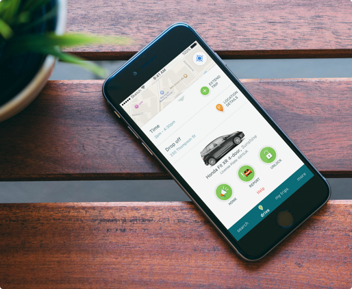 Phone on a seat with zipcar app open on reservation details