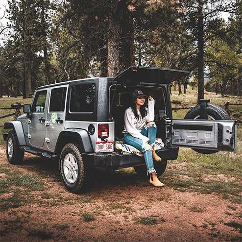 woman-sitting-in-zipcar-in-forest