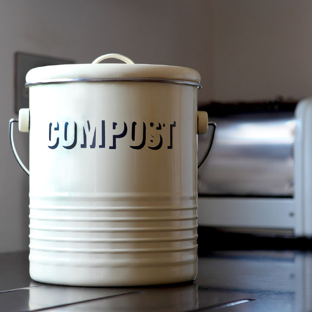 ceramic jar with the word compost on it