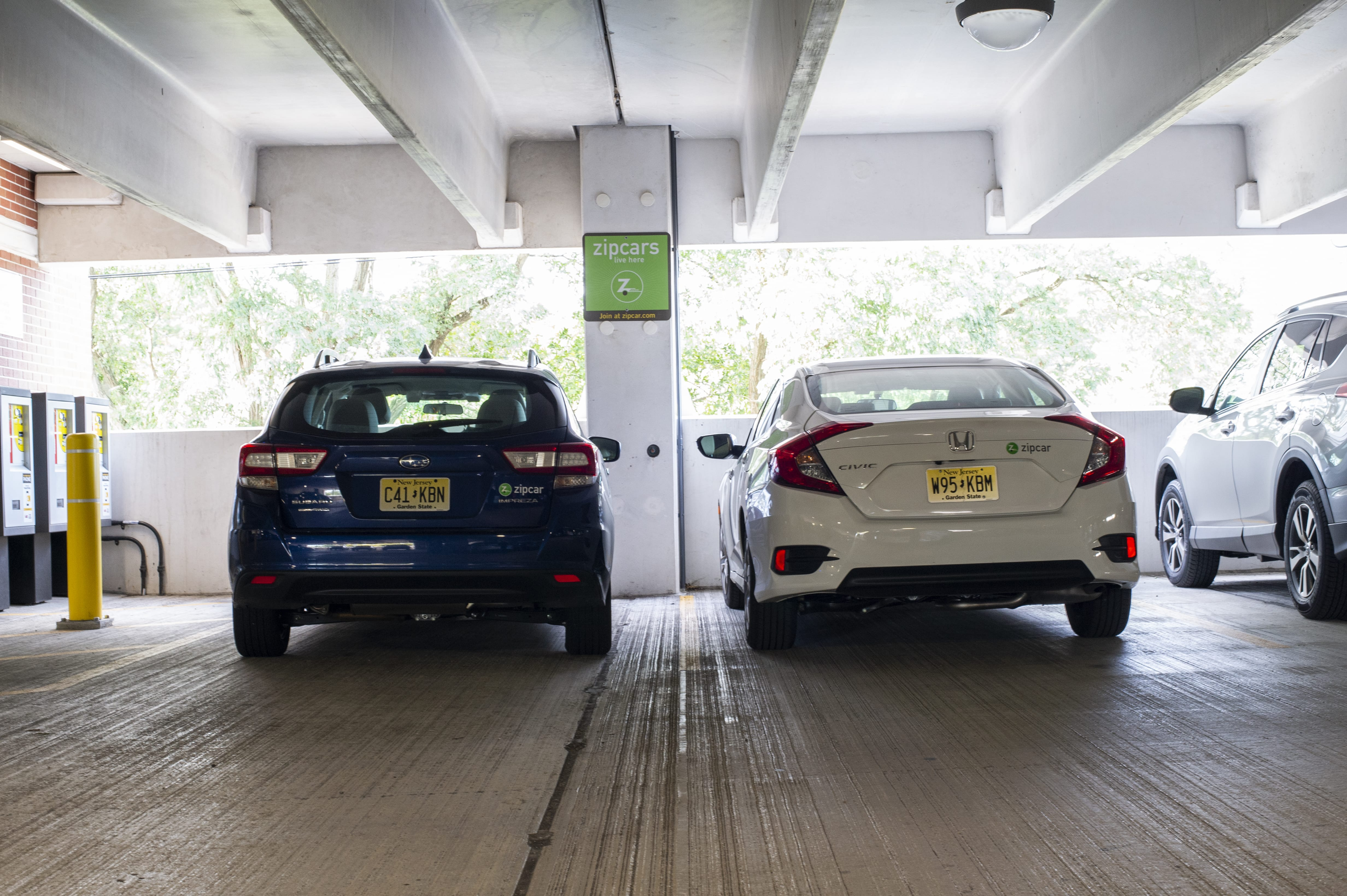 zipcars parked in spots
