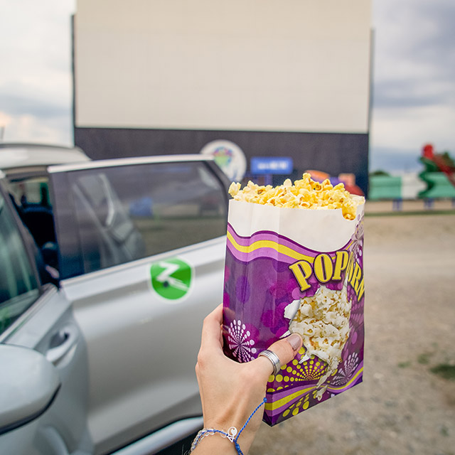 Zipcar at a drive-in theater with movie popcorn