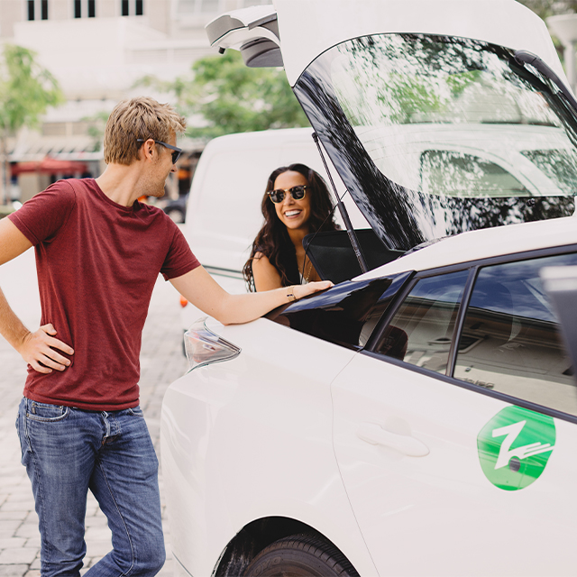 Zipcar couple unpacking trunk
