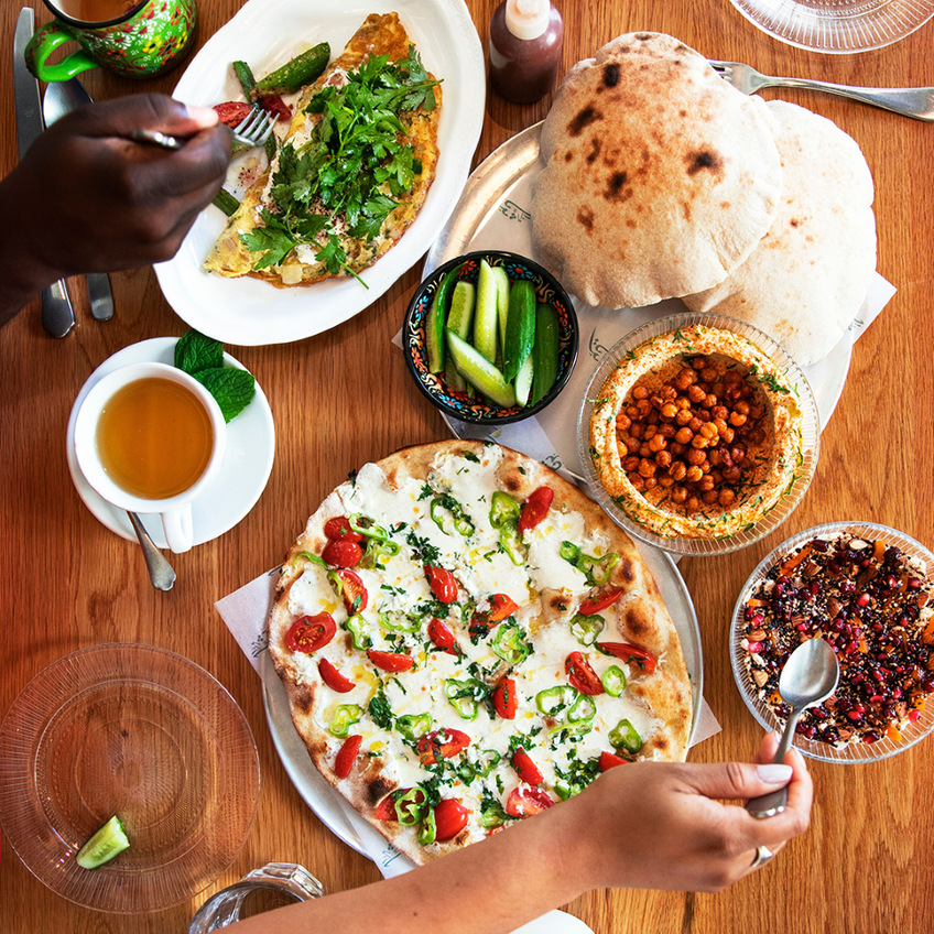 sampling a variety of foods on a table
