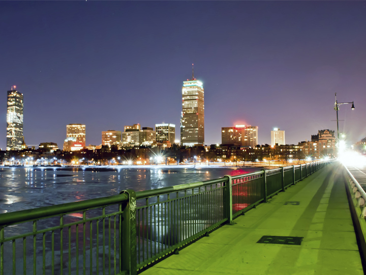 bike path with Boston skyline in background at night