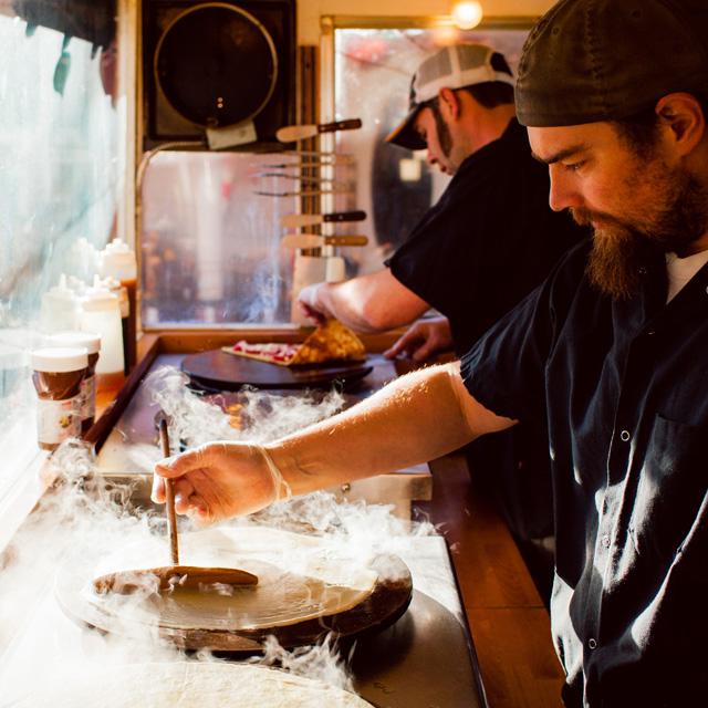 man making pizza crust