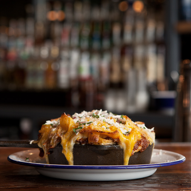 picture of Frito pie with cheese melting off onto the plate
