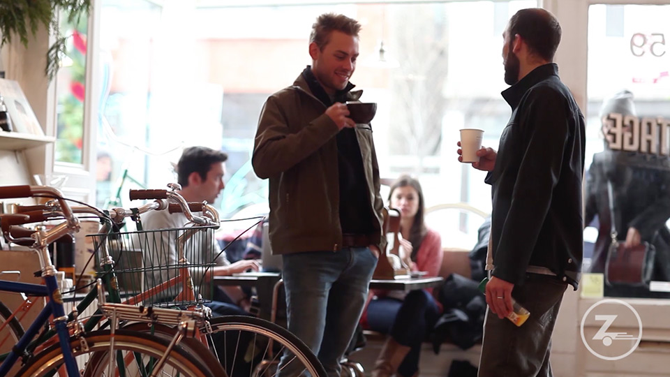 two men talking in a coffee shop