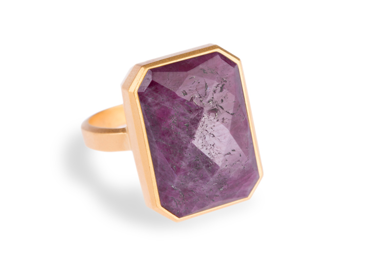gold ring with large purple cut gemstone