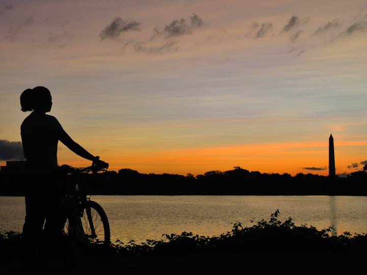 biker with sun setting