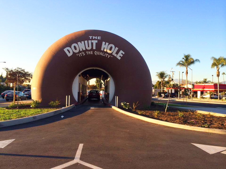 giant donut with car driving through the center
