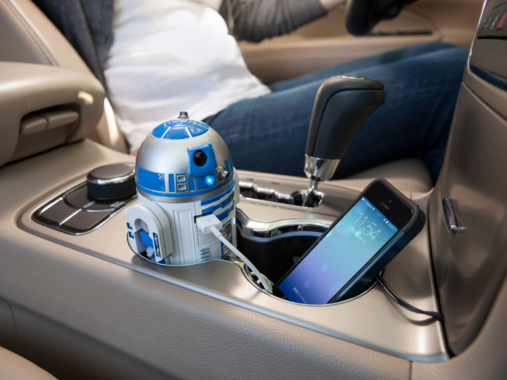 phone charger shaped like R2-D2 sitting in car cup holder