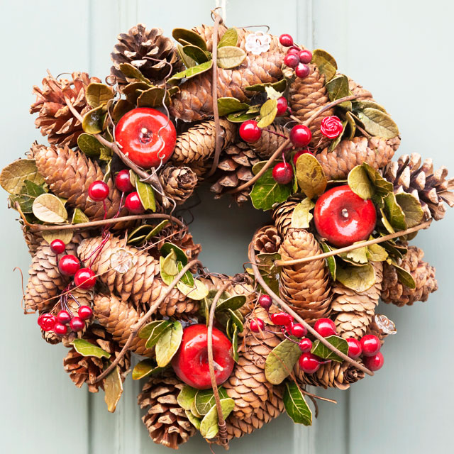 Fall wreath with apples and pine cones