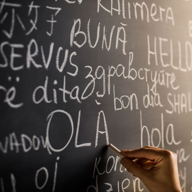 Chalkboard with different foreign languages written on it