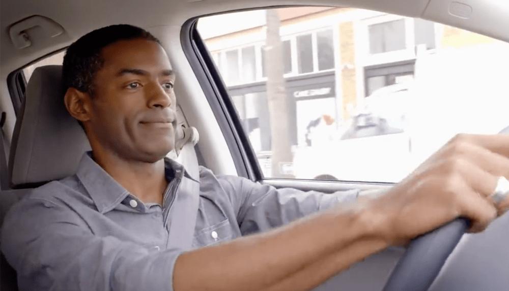 photo of man driving a car