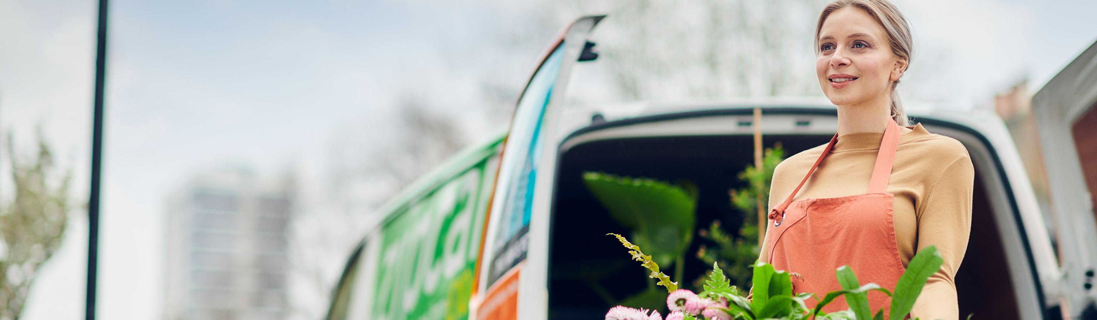 woman doing deliveries with zipcar van