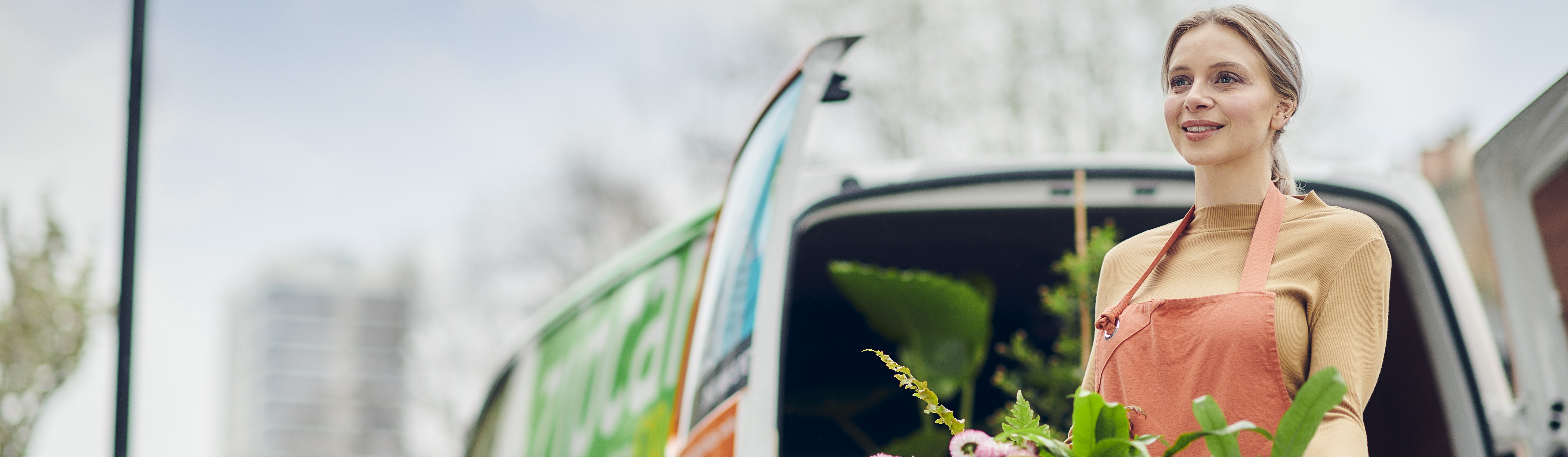 zipcar van woman holding plants