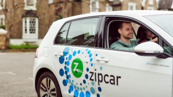 man driving a zipcar electric car