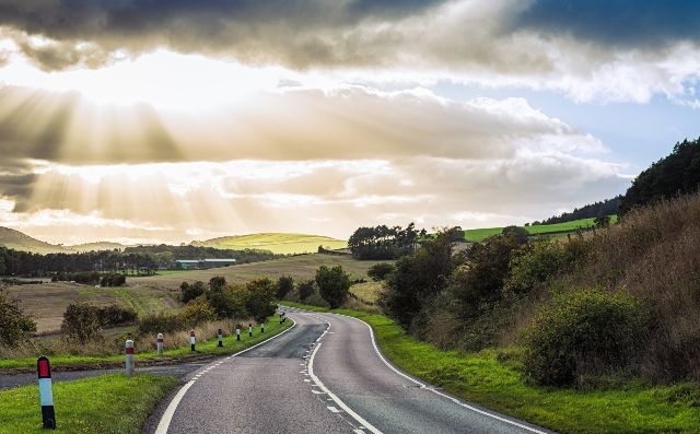 A winding road through the British countryside