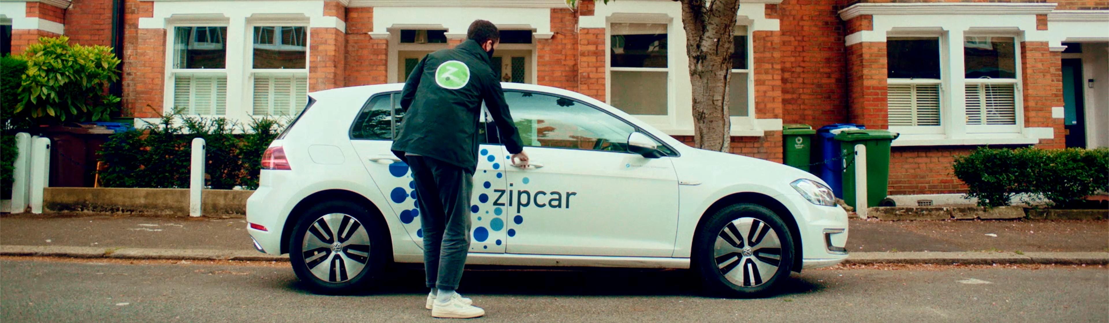 Team member opening a Zipcar door