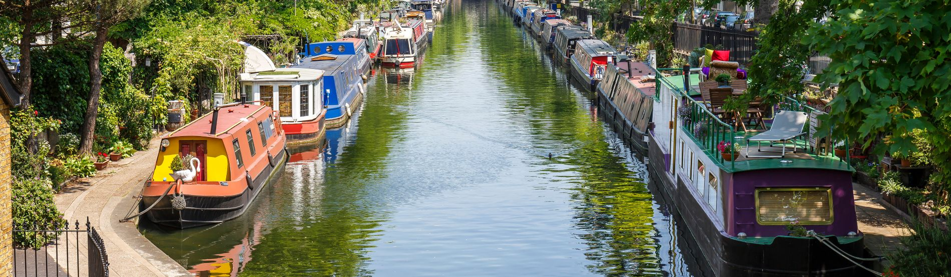 Regent's canal with canal boats either side