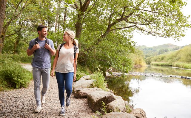 couple walking in nature reserve