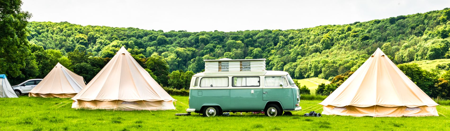 vw camper at a glamping site in the english countryside
