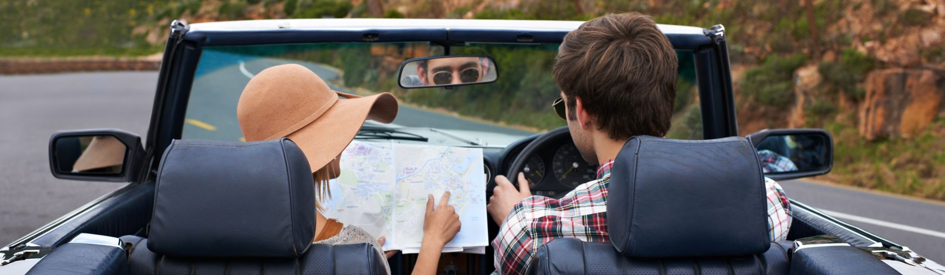 Couple on a road trip deciding where to go next