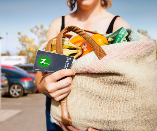 woman holding cloth shopping bag and Zipcard